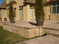 Raised patio with Ebel natural bed building stone and square cut flagstone