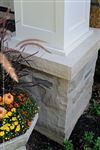 A rockfaced Indiana Limestone cap on a natural stone pillar