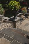 Ebel Black coping stair treads with Ebel Beige flagstone landings and custom Ebel Black caps on natural stone pillars