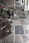 Rocking chairs on an Ebel Beige pebbletop square cut flagstone porch