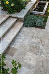 A patio, steps and garden wall built with Wiarton Buff flamed coping and custom-cut square cut flagstone pavers
