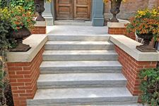 Select Grey sandblasted natural stone steps leading up to the front of a home